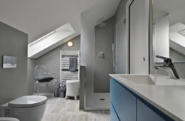 interior of modern bathroom with blue furniture  and masonry shower cubicle
